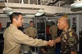 US Navy 080629-N-7730P-009 Armed Forces of the Philippines, Chief of Staff, Gen. Alexander B. Yano shares a handshake with Lt.j.g. Eduardo Vargas. Gen. Yano flew aboard USS Ronald Reagan (CVN 76).jpg