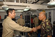 US Navy 080629-N-7730P-009 Armed Forces of the Philippines, Chief of Staff, Gen. Alexander B. Yano shares a handshake with Lt.j.g. Eduardo Vargas. Gen. Yano flew aboard USS Ronald Reagan (CVN 76)
