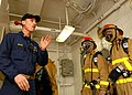 US Navy 081028-N-2456S-227 Chief Storekeeper Tim White, from San Diego, instructs Sailors how to properly battle a fire during a simulated general quarters drill aboard the aircraft carrier USS Theodore Roosevelt (CVN 71).jpg