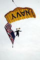 US Navy 081206-N-8492C-190 A member of the U.S. Navy demonstration parachute team the Leap Frogs drifts into Lincoln Financial Field in Philadelphia before the 109th Army-Navy college football game.jpg