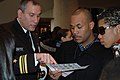 US Navy 090109-N-9268E-001 Lt. Cmdr. Cesar Plaza, an outreach officer stationed at the Navy's Diversity Directorate, explains the Navy promotion system to New York students attending the 2009 Hispanic Eastern Technical Career I.jpg