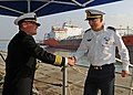 US Navy 090304-N-1082Z-002 Israel Naval Forces Rear Adm. Ram Rutberg, commander of Haifa Naval Base, is greeted by Capt. Mark D. Genung, commanding officer of the guided-missile cruiser USS Vella Gulf (CG 72) on the ship's quar.jpg