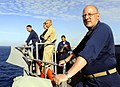 US Navy 090523-N-5345W-324 Lt. Cmdr. Brian Goldschmidt, right, executive officer of the amphibious dock landing ship USS Fort McHenry (LSD 43), watches from outside the pilothouse.jpg