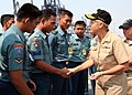US Navy 090825-N-5060D-201 Rear Adm. Nora Tyson, commander of Task Force 73, presents Indonesian sailors with command coins.jpg