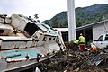 US Navy 091001-F-3798Y-213 A boat and debris are seen deposited in a church parking lot Oct. 1, 2009 in Pago Pago after a tsunami struck American Samoa Sept. 29, 2009.jpg