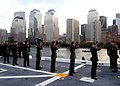 US Navy 091102-N-2147L-001(1) Marines assigned to Special Purpose Marine Air-Ground Task Force 26 fire a 21-gun salute as the amphibious transport dock ship Pre-commissioning Unit (PCU) New York (LPD 21) passes Ground Zero.jpg
