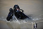 US Navy 091127-N-4154B-130 Navy Diver 1st Class Daniel Muhlbach, assigned to Mobile Diving and Salvage Unit (MDSU) 2, comes out of the water during a search for the body of U.S. Army Sgt. Brandon Islip.jpg