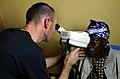 US Navy 100317-N-7948C-109 Lt. Cmdr. Mike Sunman conducts an eye examination on a Ghanaian woman during a medical outreach program at Manhean Health Center.jpg