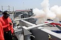 US Navy 100514-N-8913A-019 Sailors assigned to the weapons department aboard USS George H.W. Bush (CVN 77) fire one of the 15-round gun salutes during the retirement ceremony for Rear Adm. John W. Goodwin.jpg