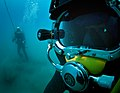 US Navy 100722-N-1134L-355 Navy Diver 2nd Class Troy Crowder, assigned to Company 2-6 of Mobile Diving and Salvage Unit (MDSU) 2, and a Mexican navy diver search the sea floor during a salvage recovery exercise.jpg