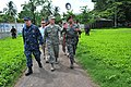 US Navy 110707-F-NJ219-296 Capt. David Weiss and Air Force Gen. Douglas Fraser walk with a member of the Guatemalan military during a Continuing Pr.jpg