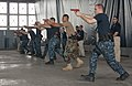 US Navy 110928-N-WX059-180 Students attending the 15-day Security Reaction Force-Basic (SRF-B) training session practice pier movements.jpg