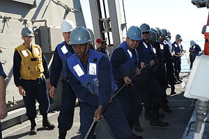 US Navy 111210-N-NP071-011 Line handlers maintain tension on a line.jpg