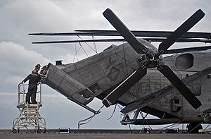 US Navy 111220-N-DX615-041 Marines perform maintenance on a CH-53E Super Stallion helicopter, assigned to the Red Dragons of Marine Medium Helicop.jpg