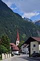 Umhausen - Ortseinfahrt nach Umhausen-Dorf mit Blick auf die Pfarrkirche hl Vitus.jpg