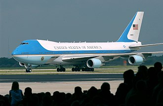 Graphic design - A Boeing 747 aircraft with livery designating it as Air Force One. The cyan forms, the US flag, presidential seal and the Caslon lettering, were all designed at different times, by different designers, for different purposes, and combined by designer Raymond Loewy in this one single aircraft exterior design.