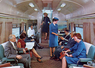 California Zephyr (1949–1970) - A Zephyrette (center, in blue uniform) at work on the lower level of a California Zephyr Vista-Dome car in 1967