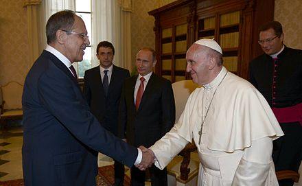 Pope Francis shaking hands with Russian Foreign Minister Sergey Lavrov, behind Russian President Vladimir Putin, 10 June 2015 Vladimir Putin with Franciscus (2015-06-10) 1.jpg
