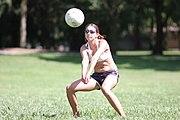 A woman making a forearm pass or bump.