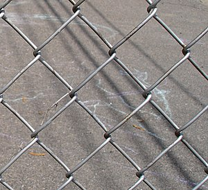 Chain-link fencing - Chain-link fencing showing the diamond patterning.