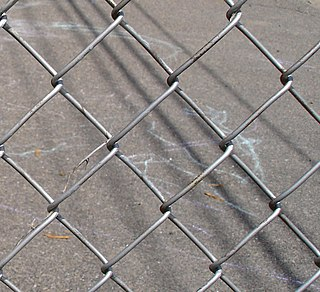 Chain-link fencing type of woven metal fencing