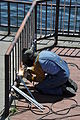 Welder adding rails to fence at Gas Works Park.jpg