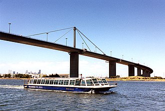 West Gate Bridge - View of the bridge with a River Cruise Boat passing under