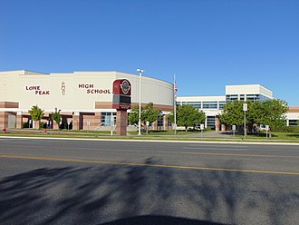 Lone Peak High School - Looking west across North County Boulevard (SR‑129) at Lone Peak High School, June 2016