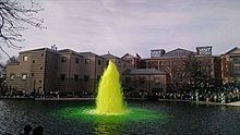 A fountain with green water