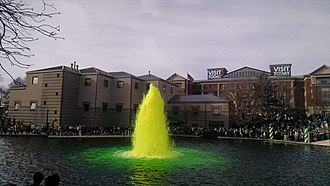 Saint Patrick's Day in the United States - The White River in Indianapolis is dyed green in celebration of St. Patrick's Day, 2015
