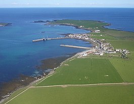 An aerial view of Whitehall, with Grice Ness at the end of Stronsay's north-eastern peninsula