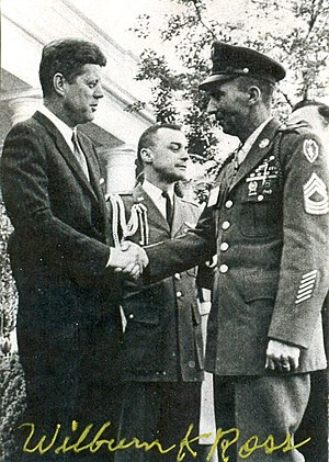 Wilburn K. Ross - Wilburn K. Ross (right), being congratulated by President John F. Kennedy