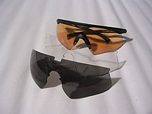 3864d8394a3a04 This sunglass eyeshield uses a nylon half-frame and interchangeable lenses