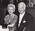 William Boyd shares a smile with his wife Grace Bradley at the Stork Club, 1954.jpg