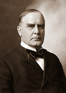 A headshot of McKinley in formal attire
