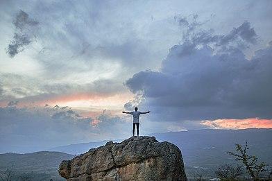 Woman standing on a rock near Villa de Leyva, Colombia (Unsplash).jpg