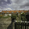 Zicht op achtergevels met tuintjes - Sluis - 20398664 - RCE.jpg
