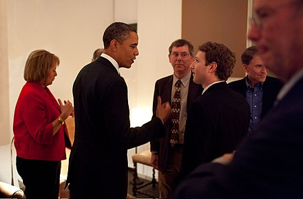 Zuckerberg listening to President Barack Obama before a private meeting where Obama dined with technology business leaders in Woodside, California, February 17, 2011. Zuckerberg meets Obama.jpg