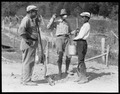 """Water boy and two workers on the roadway to Norris Dam site."" - NARA - 532704.tif"
