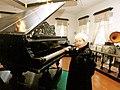 Пахмутова у рояля на котором учился играть С Прокофьев в с Красное.jpg