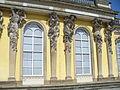1032.Die mit 36 Bacchantenhermen und Bachantinnen beschmückte Südfassade Sanssoucis Steffen Heilfort.JPG