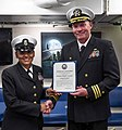 170427 - CAPT Fortson gives CMDCM Veronica Holliday reenlistment certificate.jpg