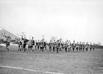 Marching band - The University of Detroit Band performing at Dinan Field in the 1920s.