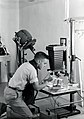 1958. Entomologist Peter W. Orr with clinical camera setup for macro-photography. Sellwood Lab. Portland, OR. (32747144794).jpg