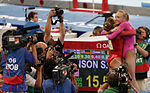 2008 Summer Olympics - Liukin hugs Johnson.jpg