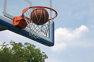 English: A ball about to fall through the hoop...
