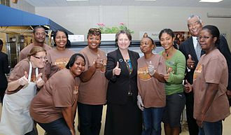 Kathleen Merrigan - Merrigan posing with cafeteria nutrition staff while visiting Carl G. Renfroe Middle School in Decatur, Georgia in 2011
