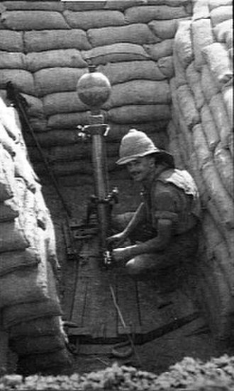 2-inch Medium Mortar - Typical mortar pit, Mesopotamia 1917, with firing lanyard laid out. The bomb is fuzed.