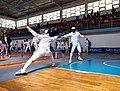 2nd Leonidas Pirgos Fencing Tournament. Advance lunge by the fencer on the left, 8th parry by the fencer on the right.jpg