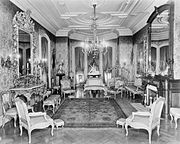 Drawing room with chandelier, gilded furniture, and ornate mirrors